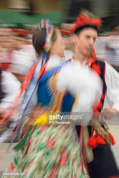 Poland, Krakow, traditional dancers, (blurred motion)
