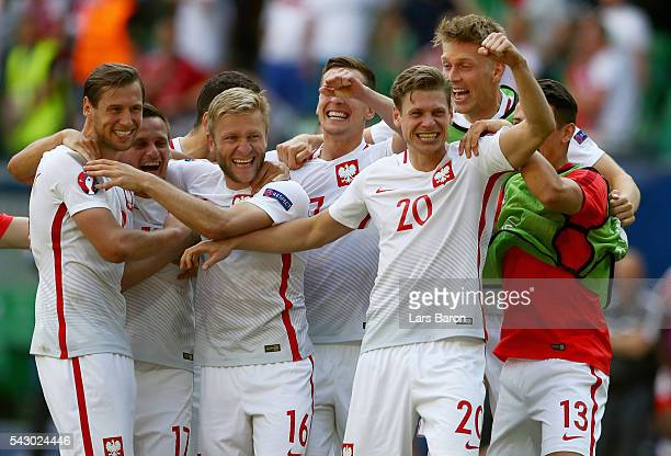 Poland players celebrate victory after the UEFA EURO 2016 round of 16 match between Switzerland and Poland at Stade GeoffroyGuichard on June 25 2016...