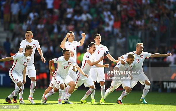 Poland players dash to celebrate as Grzegorz Krychowiak scores the penalty to win the game durign the UEFA EURO 2016 round of 16 match between...