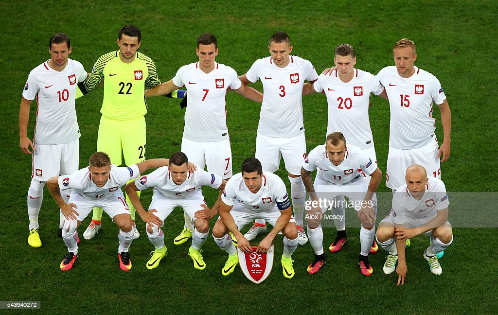 Poland players line up for the team photos prior to the UEFA EURO 2016 quarter final match between Poland and Portugal at Stade Velodrome on June 30, 2016 in Marseille, France.