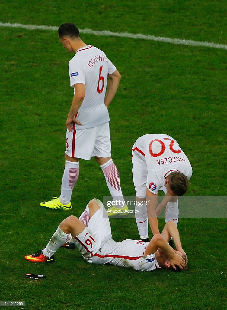 Poland players look dejected after the penalty shoot-out following the UEFA Euro 2016 quarter Final match between Poland and Portugal at Stade Velodrome on June 30, 2016 in Marseille, France.