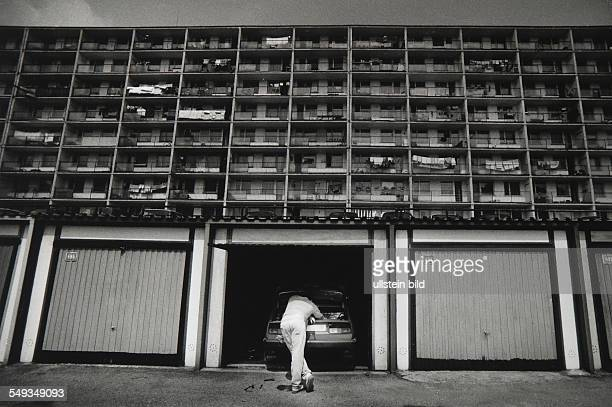 Poland Posnan man with car in garage in front of social housingestate