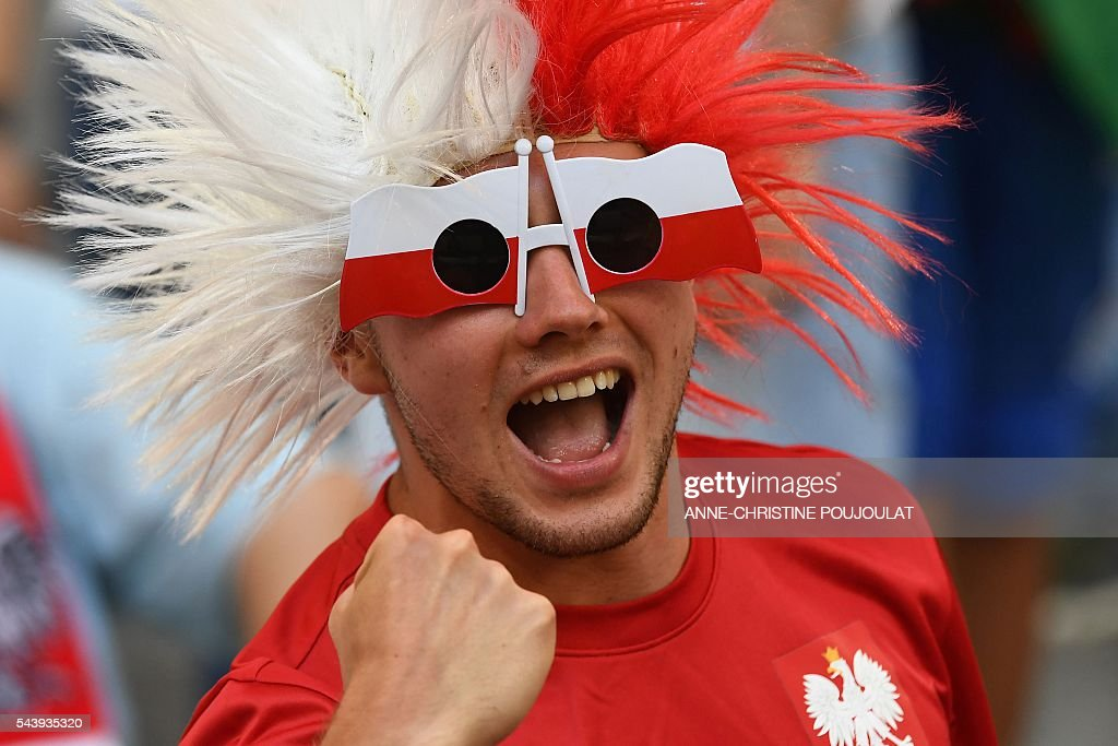 A Poland supporter cheers prior to the Euro 2016 quarter-final football match between Poland and Portugal at the Stade Velodrome in Marseille on June 30, 2016. / AFP / ANNE