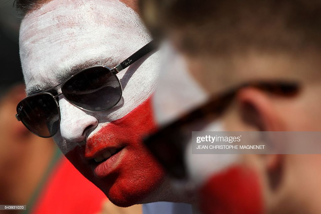 A Poland supporter looks on ahead of the Euro 2016 championship match between Poland and Portugal, in Marseille, southern France, on June 30, 2016. / AFP / JEAN