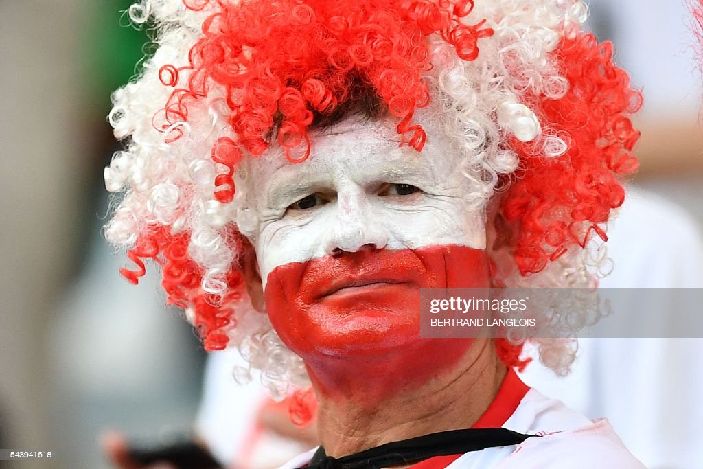 A Poland supporter looks on prior to the Euro 2016 quarter-final football match between Poland and Portugal at the Stade Velodrome in Marseille on June 30, 2016. / AFP / BERTRAND