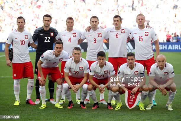 Poland's Grzegorz Krychowiak goalkeeper Lukasz Fabianski Thiago Cionek Artur JedrzejczykTomasz Jodlowiec Kamil Glik Front row Poland's Arkadiusz...