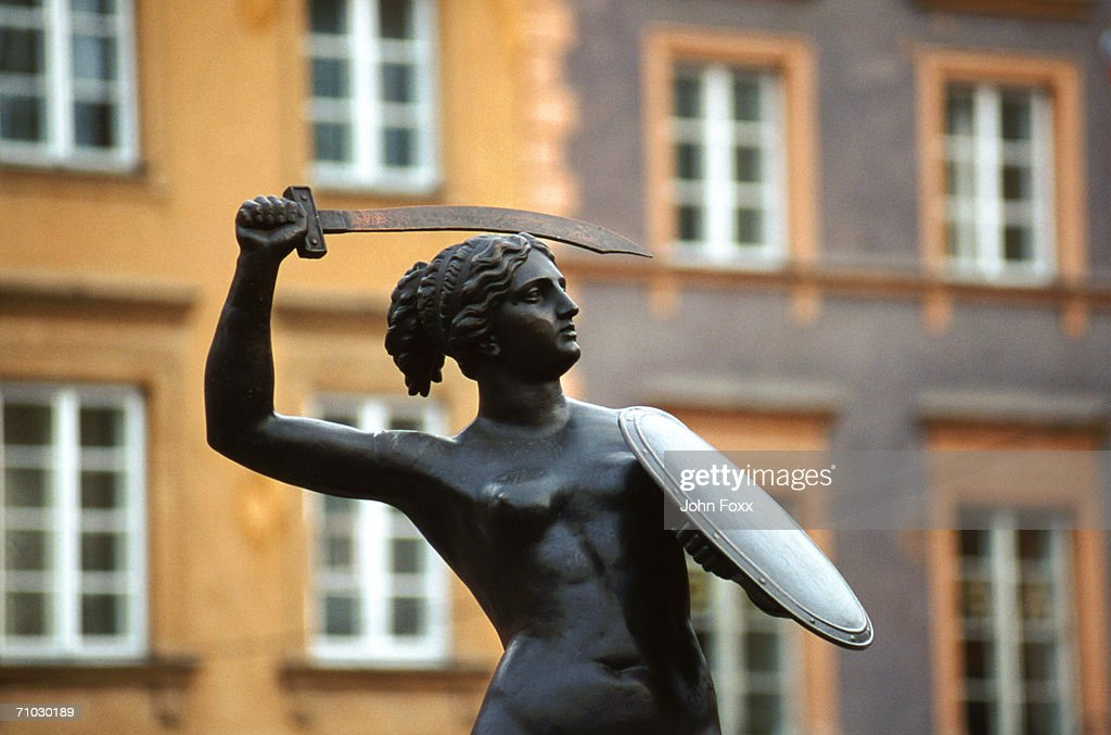 Poland, Warcaw, Statue in front of building exterior : Stock Photo