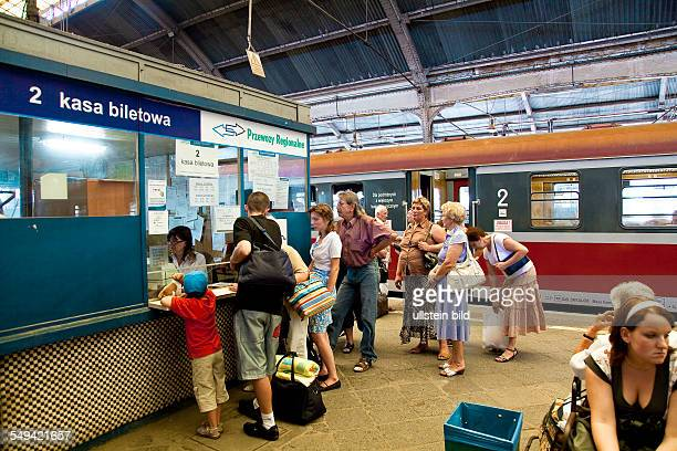 Passengers waiting to buy a ticket at a ticket office in the central station