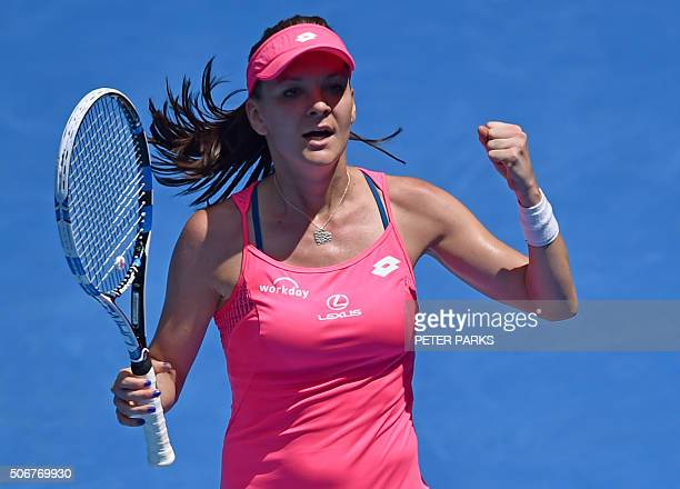Poland's Agnieszka Radwanska celebrates after victory in her women's singles match against Spain's Carla Suarez Navarro on day nine of the 2016...