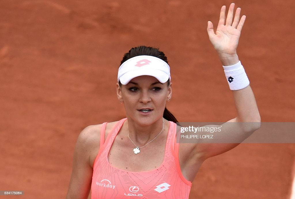 Poland's Agnieszka Radwanska celebrates after winning her women's second round match France's Caroline Garcia at the Roland Garros 2016 French Tennis Open in Paris on May 25, 2016. / AFP / PHILIPPE