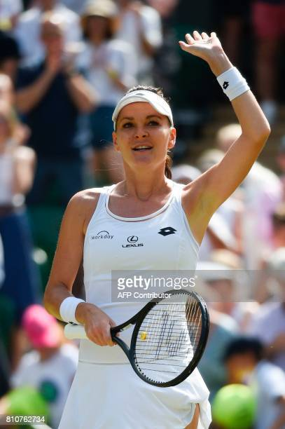 Poland's Agnieszka Radwanska celebrates beating Switzerland's Timea Bacsinszky during their women's singles third round match on the sixth day of the...
