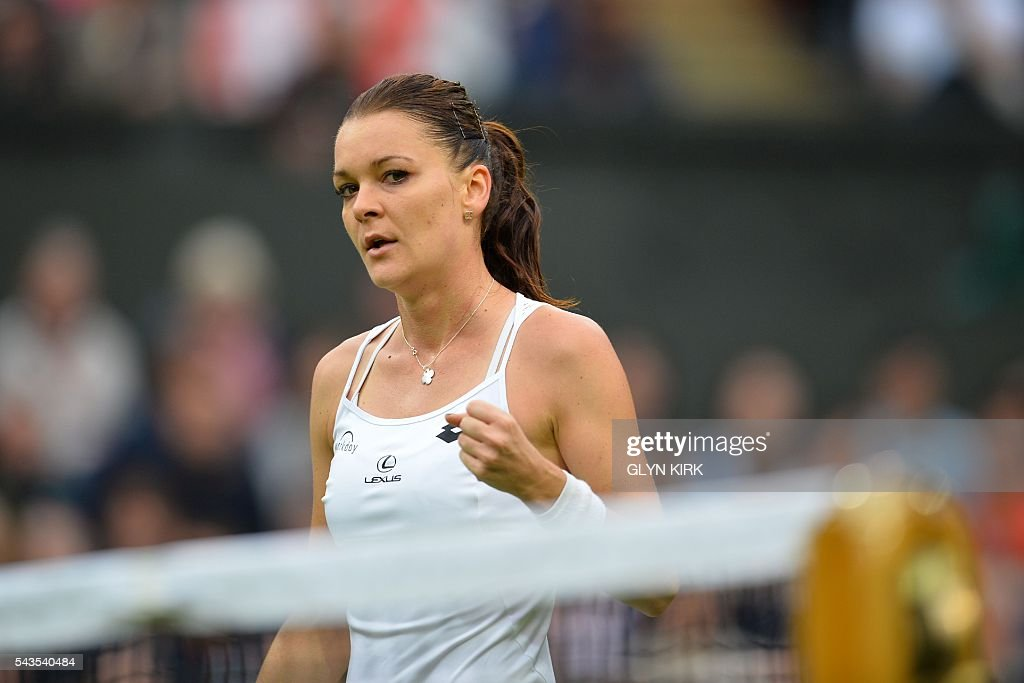 Poland's Agnieszka Radwanska celebrates winning the first set against Ukraine's Kateryna Kozlova during their women's singles first round match on the third day of the 2016 Wimbledon Championships at The All England Lawn Tennis Club in Wimbledon, southwest London, on June 29, 2016. / AFP / GLYN