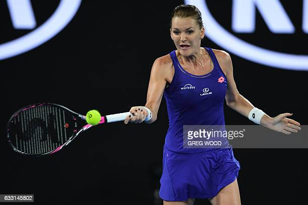 Poland's Agnieszka Radwanska hits a return against Bulgaria's Tsvetana Pironkova during their women's singles match on day two of the Australian Open...