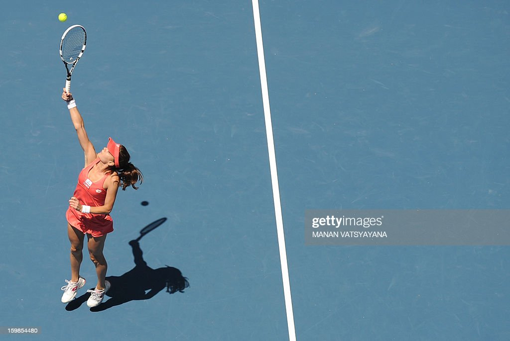 Poland's Agnieszka Radwanska hits a return against China's Li Na during their women's singles match on day nine of the Australian Open tennis tournament in Melbourne on January 22, 2013. AFP PHOTO / MANAN VATSYAYANA IMAGE STRICTLY RESTRICTED TO EDITORIAL USE - STRICTLY NO COMMERCIAL USE
