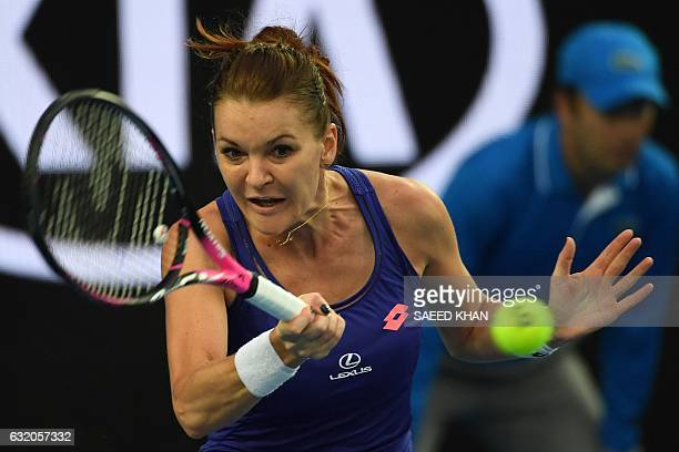 Poland's Agnieszka Radwanska hits a return against Croatia's Mirjana LucicBaroni during their women's singles second round match on day four of the...