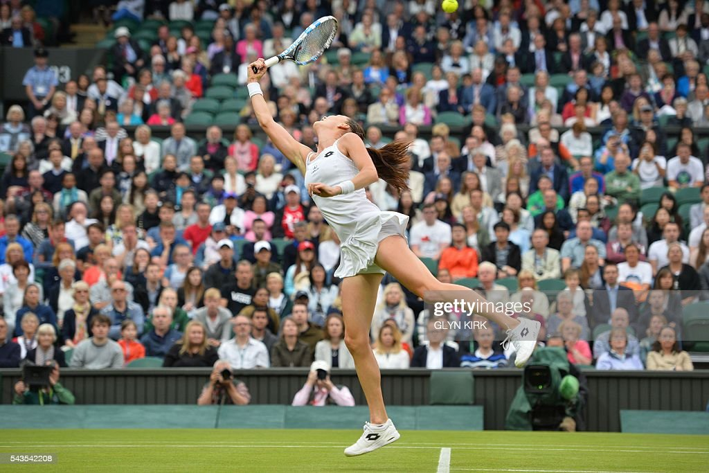 Poland's Agnieszka Radwanska jumps for a return against Ukraine's Kateryna Kozlova during their women's singles first round match on the third day of the 2016 Wimbledon Championships at The All England Lawn Tennis Club in Wimbledon, southwest London, on June 29, 2016. / AFP / GLYN