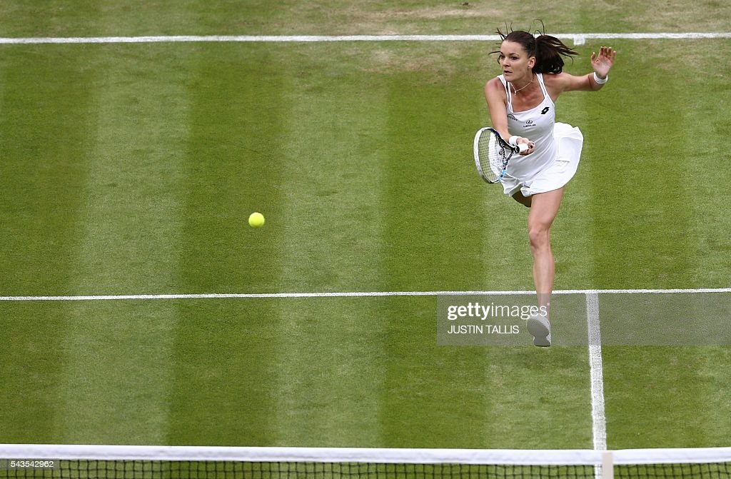 Poland's Agnieszka Radwanska jumps returns to Ukraine's Kateryna Kozlova during their women's singles first round match on the third day of the 2016 Wimbledon Championships at The All England Lawn Tennis Club in Wimbledon, southwest London, on June 29, 2016. / AFP / JUSTIN