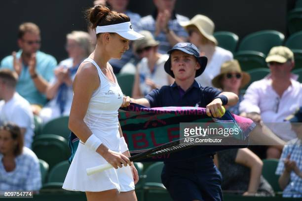 Poland's Agnieszka Radwanska reacts after losing the first set to US player Christina McHale during their women's singles second round match on the...
