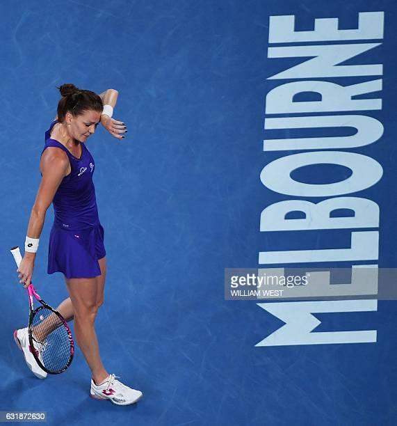 Poland's Agnieszka Radwanska reacts to a point against Bulgaria's Tsvetana Pironkova during their women's singles match on day two of the Australian...