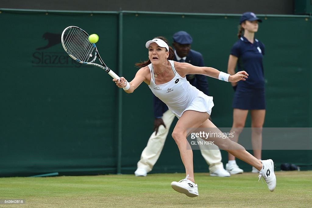 Poland's Agnieszka Radwanska returns against Croatia's Ana Konjuh during their women's singles second round match on the fourth day of the 2016 Wimbledon Championships at The All England Lawn Tennis Club in Wimbledon, southwest London, on June 30, 2016. / AFP / GLYN