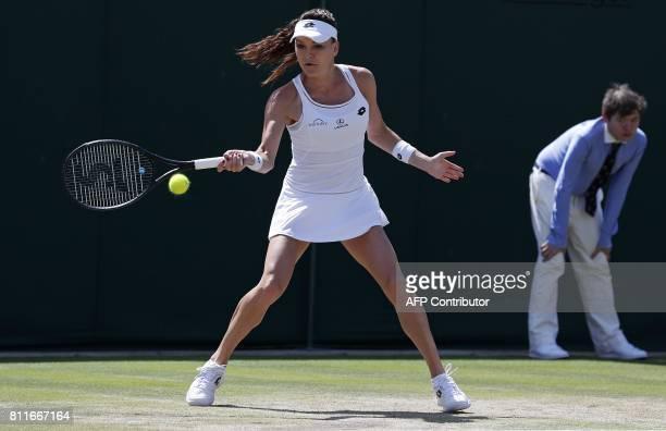 Poland's Agnieszka Radwanska returns against Russia's Svetlana Kuznetsova during their women's singles fourth round match on the seventh day of the...