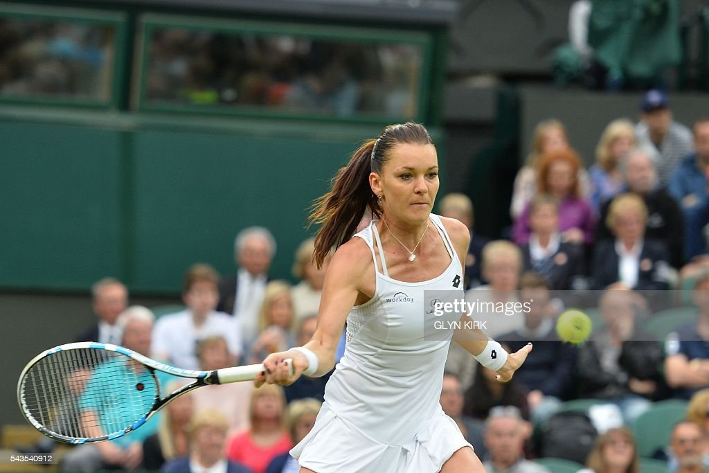 Poland's Agnieszka Radwanska returns against Ukraine's Kateryna Kozlova during their women's singles first round match on the third day of the 2016 Wimbledon Championships at The All England Lawn Tennis Club in Wimbledon, southwest London, on June 29, 2016. / AFP / GLYN