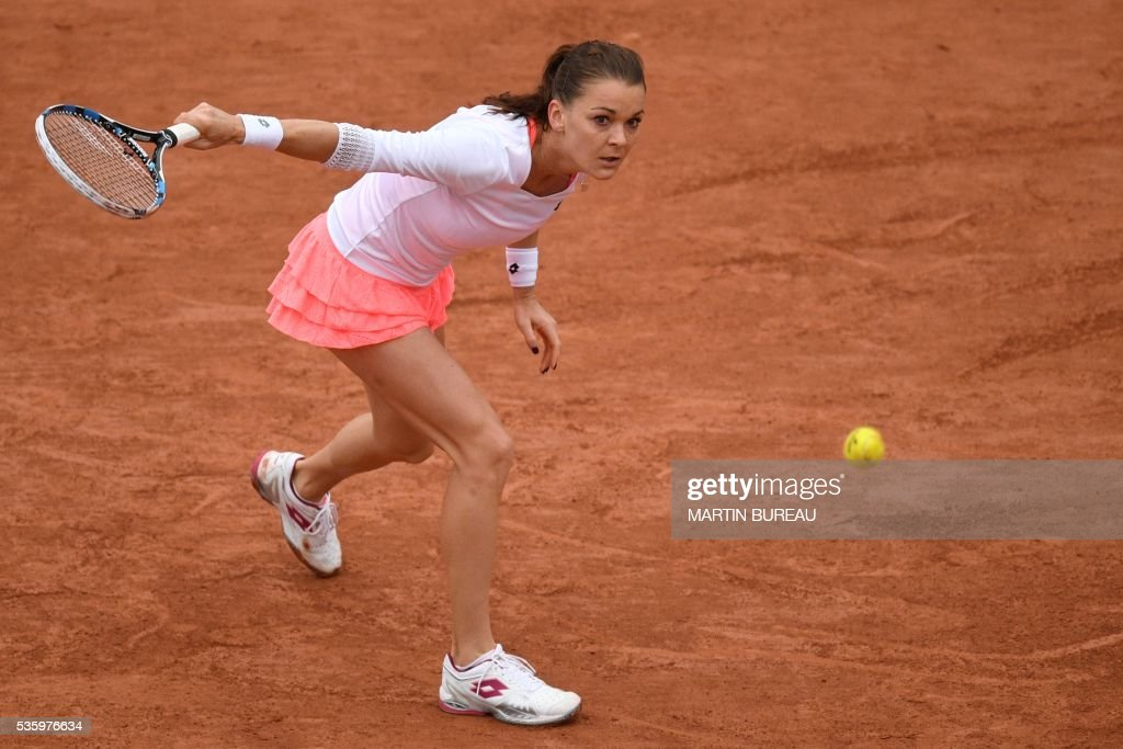 CORRECTION - Poland's Agnieszka Radwanska returns the ball to Bulgaria's Tsvetana Pironkova during their women's fourth round match at the Roland Garros 2016 French Tennis Open in Paris on May 31, 2016. / AFP / MARTIN BUREAU / The erroneous mention[s] appearing in the metadata of this photo by MARTIN BUREAU has been modified in AFP systems in the following manner: [Poland's Agnieszka Radwanska returns the ball to Bulgaria's Tsvetana Pironkova] instead of [Romania's Simona Halep serves the ball to Australia's Samantha Stosur]. Please immediately remove the erroneous mention[s] from all your online services and delete it (them) from your servers. If you have been authorized by AFP to distribute it (them) to third parties, please ensure that the same actions are carried out by them. Failure to promptly comply with these instructions will entail liability on your part for any continued or post notification usage. Therefore we thank you very much for all your attention and prompt action. We are sorry for the inconvenience this notification may cause and remain at your disposal for any further information you may require.