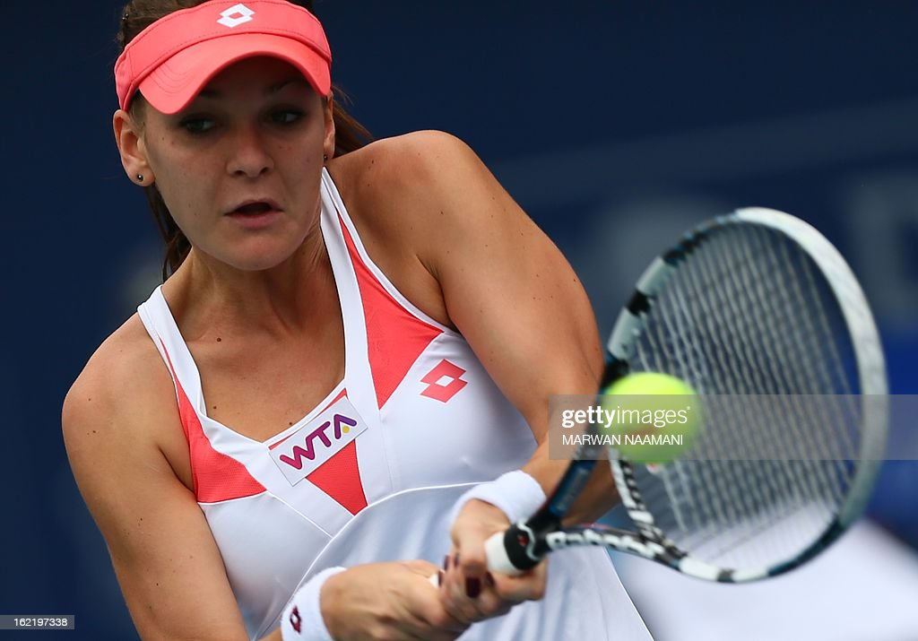 Poland's Agnieszka Radwanska returns the ball to Kazakhstan's Yulia Putintseva during their WTA Dubai Open tennis match in the Gulf emirate on February 20, 2013.