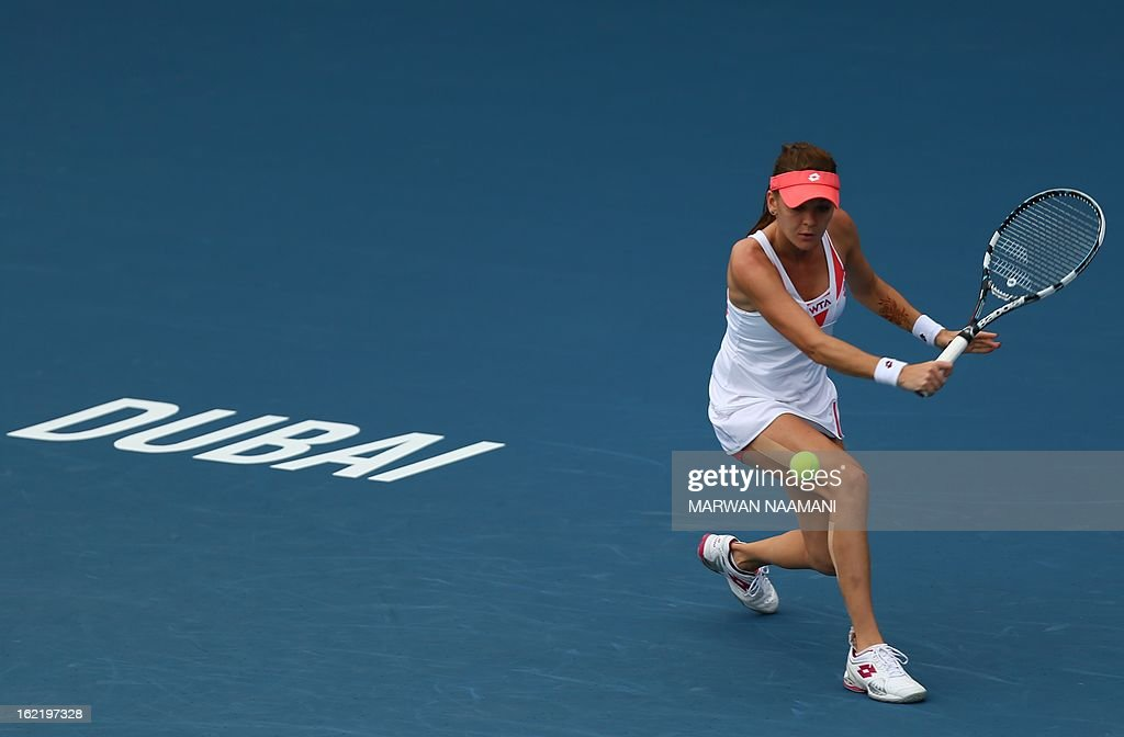 Poland's Agnieszka Radwanska returnst he ball to Kazakhstan's Yulia Putintseva during their WTA Dubai Open tennis match in the Gulf emirate on February 20, 2013.