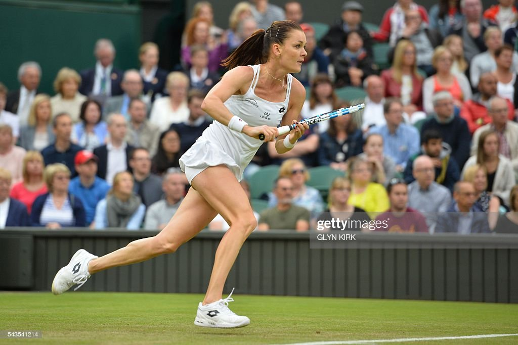 Poland's Agnieszka Radwanska runs in to reach a drop shot from Ukraine's Kateryna Kozlova during their women's singles first round match on the third day of the 2016 Wimbledon Championships at The All England Lawn Tennis Club in Wimbledon, southwest London, on June 29, 2016. / AFP / GLYN