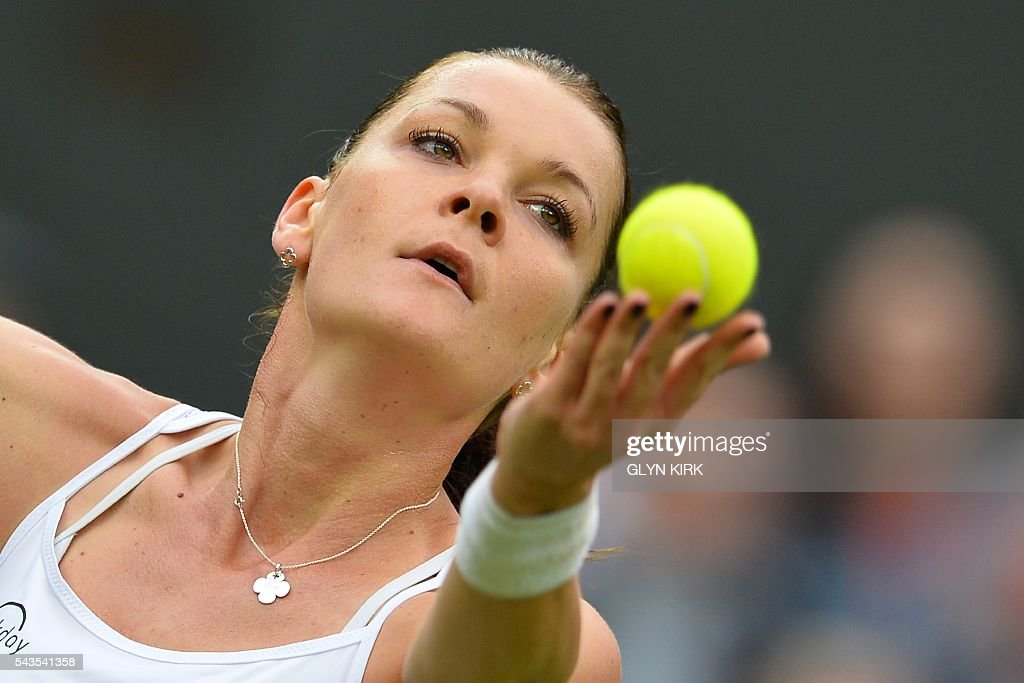 Poland's Agnieszka Radwanska serves against Ukraine's Kateryna Kozlova during their women's singles first round match on the third day of the 2016 Wimbledon Championships at The All England Lawn Tennis Club in Wimbledon, southwest London, on June 29, 2016. / AFP / GLYN