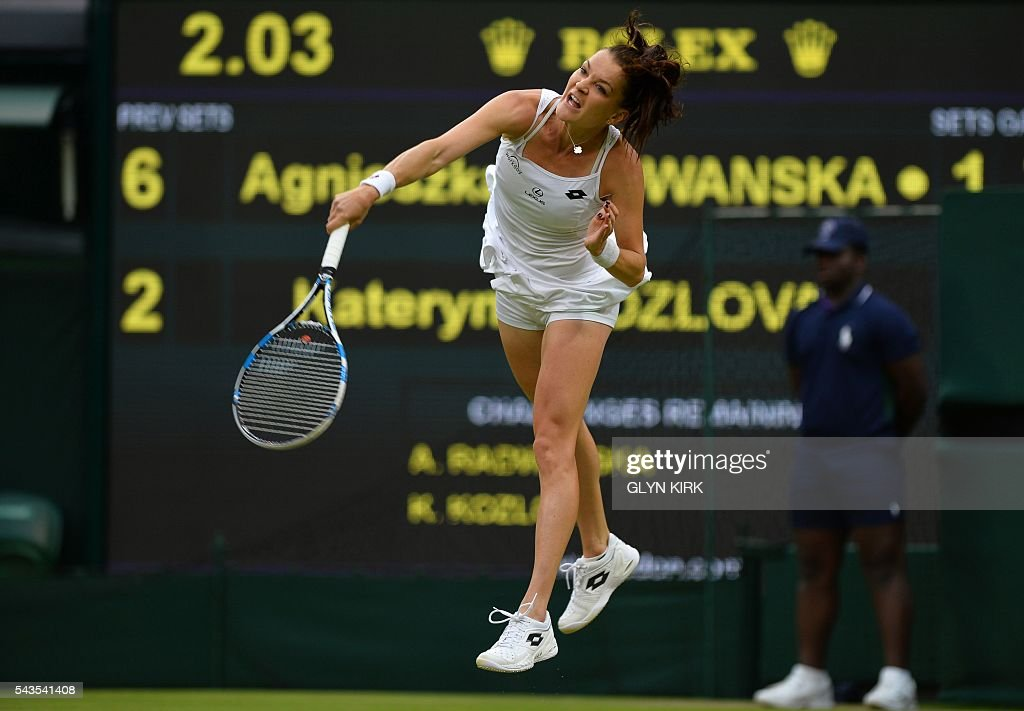 Poland's Agnieszka Radwanska serves against Ukraine's Kateryna Kozlova uring their women's singles first round match on the third day of the 2016 Wimbledon Championships at The All England Lawn Tennis Club in Wimbledon, southwest London, on June 29, 2016. / AFP / GLYN