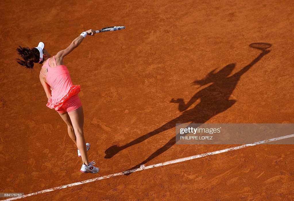 Poland's Agnieszka Radwanska serves the ball to France's Caroline Garcia during their women's second round match against at the Roland Garros 2016 French Tennis Open in Paris on May 25, 2016. / AFP / PHILIPPE