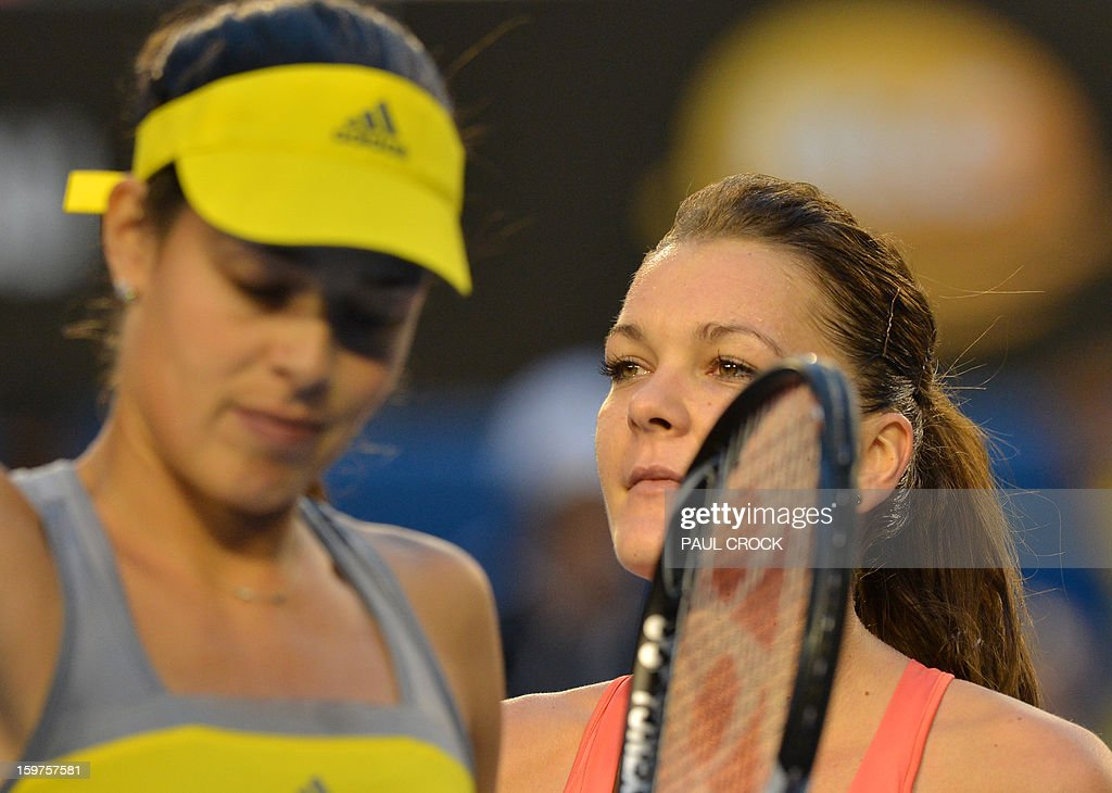 Poland's Agnieszka Radwanska (R) walks off court after victory in her women's singles match against Serbia's Ana Ivanovic (L) on the seventh day of the Australian Open tennis tournament in Melbourne on January 20, 2013.