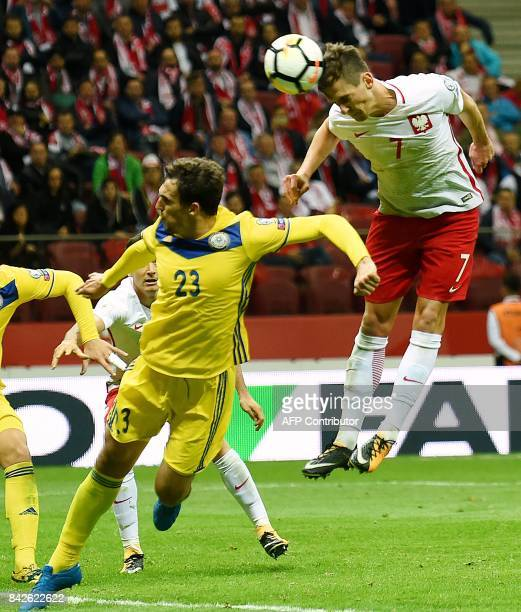 Poland's Arkadiusz Milik and Kazakhstan's defender Yuriy Logvinenko vie for the ball during the FIFA World Cup 2018 qualification match between...