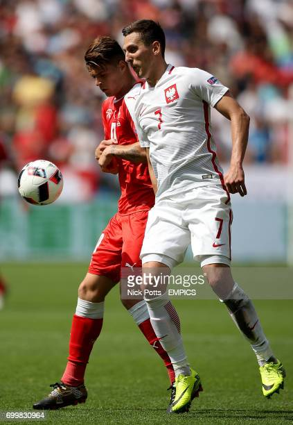 Poland's Arkadiusz Milik and Switzerland's Granit Xhaka battle for the ball