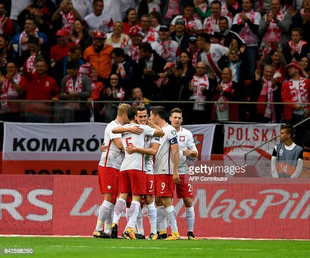 Poland's Arkadiusz Milik celebrates scoring a goal with team mates during the FIFA World Cup 2018 qualification match between Poland and Kazakhstan...