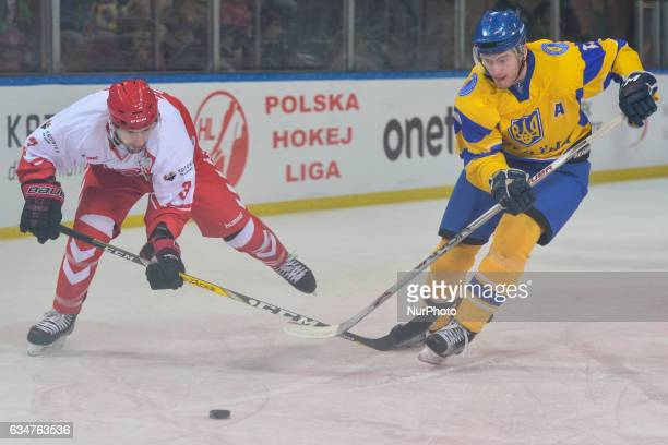 Poland's Bartosz Ciura in action against Ukraine's Vladyslav Gavrik during an EURO ICE Hockey tournament Match at Spodek Arena in Katowice On Friday...