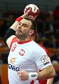 Poland's Bartosz Jurecki attempts a shot on goal during the 24th Men's Handball World Championships preliminary round Group D match between Poland...