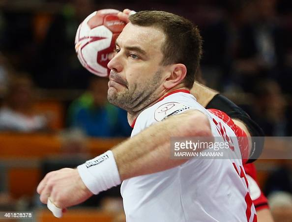 Poland's Bartosz Jurecki attempts a shot on goal during the 24th Men's Handball World Championships preliminary round Group D match between Poland...