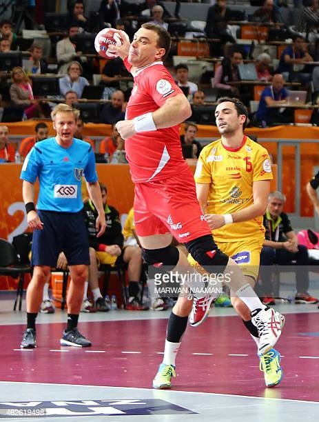Poland's Bartosz Jurecki attempts a shot on goal during the 24th Men's Handball World Championships 3rd place match between Spain and Poland at the...