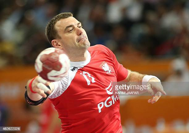 Poland's Bartosz Jurecki attempts a shot on goal during the 24th Men's Handball World Championships 3rd place match between Poland and Spain at the...