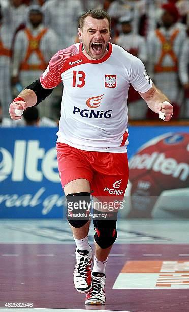 Poland's Bartosz Jurecki celebrates after a position during the 24th Men's Handball World Championships semifinal handball match between Poland and...