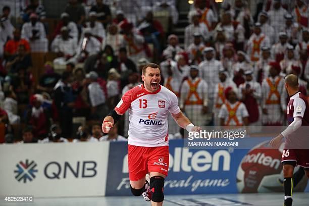 Poland's Bartosz Jurecki celebrates after scoring a goal during the 24th Men's Handball World Championships semifinals match between Qatar and Poland...