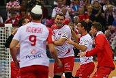 Poland's Bartosz Jurecki celebrates their win with team mates during the 24th Men's Handball World Championships quarterfinals match between Poland...