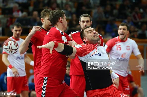 Poland's Bartosz Jurecki passes the ball during the 24th Men's Handball World Championships preliminary round Group D match between Poland and Russia...