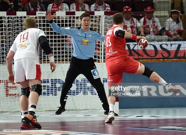 Poland's Bartosz Jurecki takes a shot on goal as Denmark's Niklas Landin defends during the 24th Men's Handball World Championships preliminary round...
