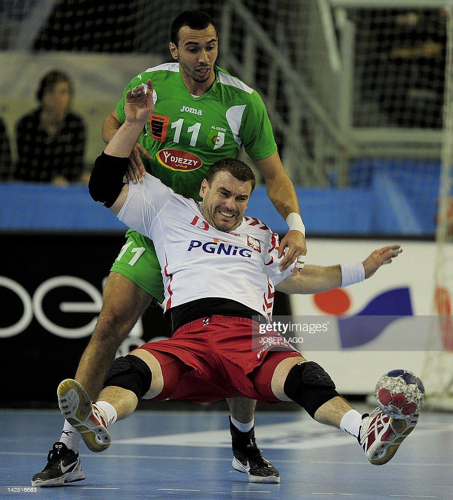 Poland's Bartosz Jurecki (down) vies with Algeria's Malik Boubaiou (up) during the handball pre-Olympic qualifying match Poland vs Algeria on April 6, 2012 at the Tecnificacion Center sports hall in Alicante.