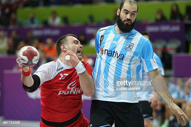 Poland's Bartosz Jurecki vies with Argentina's Leonardo Querin during the 24th Men's Handball World Championships preliminary round Group D match...