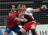 Poland's Bartosz Jurecki vies with Serbia's Alem Toskic and Nenad Vuckovic during their World Handball Championship match in Zadar on January 25 2009...
